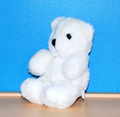 Peluche petit ourson blanc assis